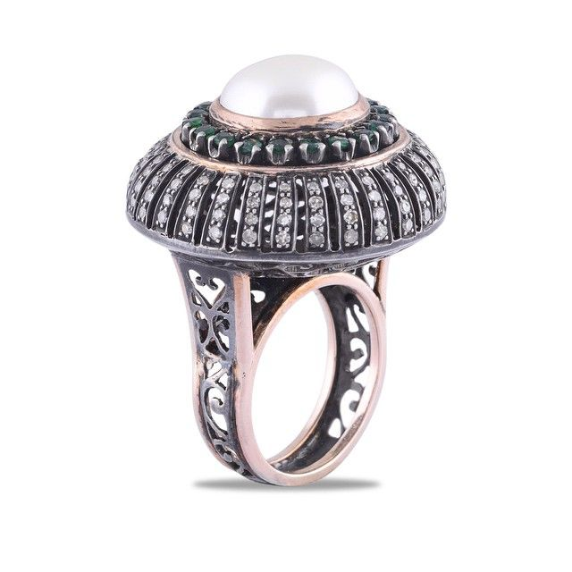 One of our remarkable rings in Victorian style studded with #diamonds #emeralds and #pearl. #trulymadeforclass #antiquariat