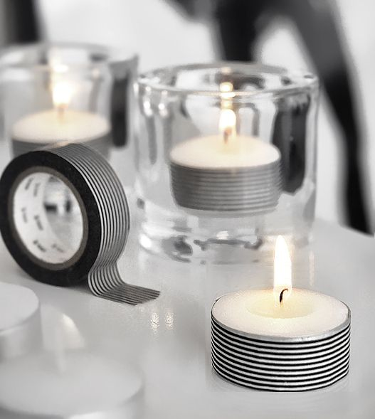 Adding decorative tape or Washi tape to tea lights is an easy DIY elegant party or wedding decoration.