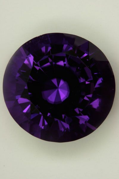 feels that this is one of the rarest gemstones to ever come out of Mozambique. It has the power to move me when bright diffused natural light illuminates the gemstone. It tends to loose saturation in incandescent light, but it is still purple with purple flash.