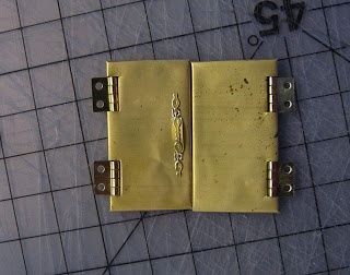 Miniature Dreamworld - how to make metal looking doors from cardboard with hinges. Lots of other ideas on this blog