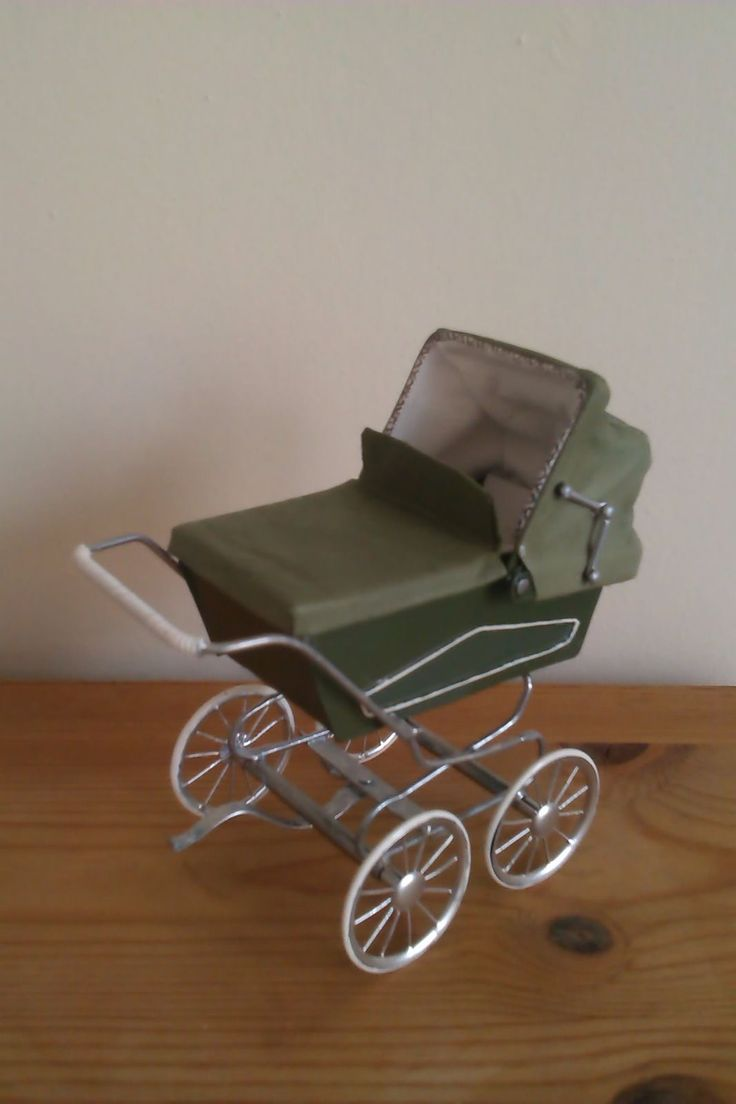 Roberson Miniatures 1960's mid green pram with matching hood and white interior