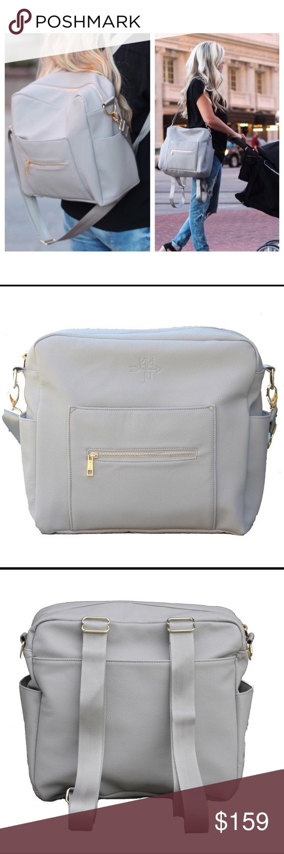Gray Kiki Lu Diaper Bag This is a super cute diaper bag! It is in the color Gray and made by Kiki Lu designs! It can be worn as a backback or as a messenger bag! This is brand new and retails for $180! Just selling because recieved another similar baby bag as a gift. Kiki Lu Bags Baby Bags
