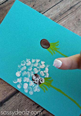 Tapa álbum dientes de león. Dibujar flores con los dedos. Experimentar la textura de la pintura con los dedos