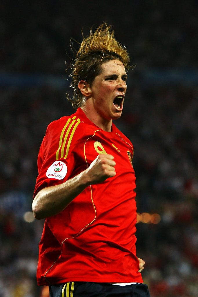 Fernando Torres Photos Photos - Fernando Torres of Spain celebrates the opening goal during the UEFA EURO 2008 Final match between Germany and Spain at Ernst Happel Stadion on June 29, 2008 in Vienna, Austria. - Germany v Spain - UEFA EURO 2008 Final
