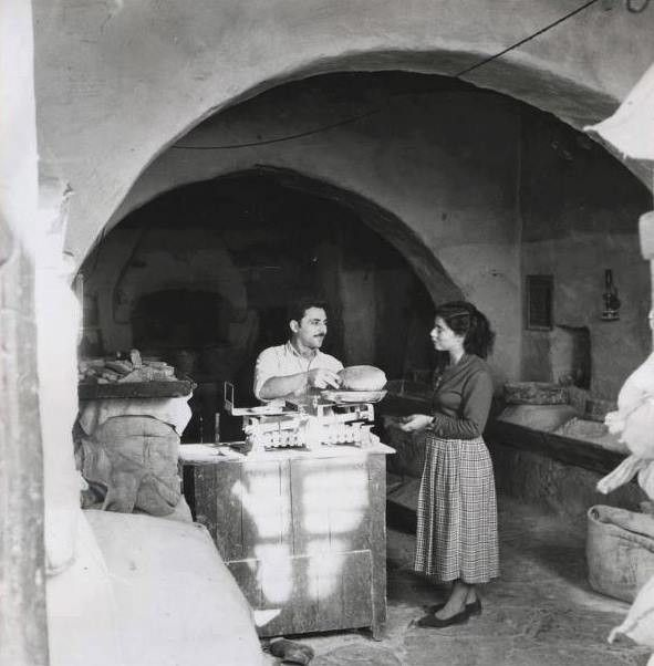 Bakery in Mykonos, Greece' by Michael J. Vamvakouri, 1950's.