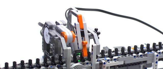 """LEGO Turing Machine by ecalpemos. This is a short documentary about the LEGO Turing Machine built by Jeroen van den Bos and Davy Landman at Centrum Wiskunde & Informatica (CWI), Amsterdam (Netherlands). They built it for CWI's exposition """"Turings Erfenis"""" in honor of the centenary of Alan Turing's birth on 23 June 1912."""