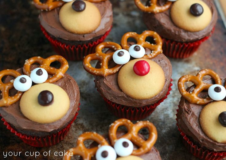 Reindeer cupcakes! They're cute and adorable and so yummy I got this from Bethany mota. All you need is chocolate cake mix, chocolate frosting, Nilla wafers, m&ms, eye candy (or brown m&ms if you can't find any) and pretzels. They're very easy to do and fun to make