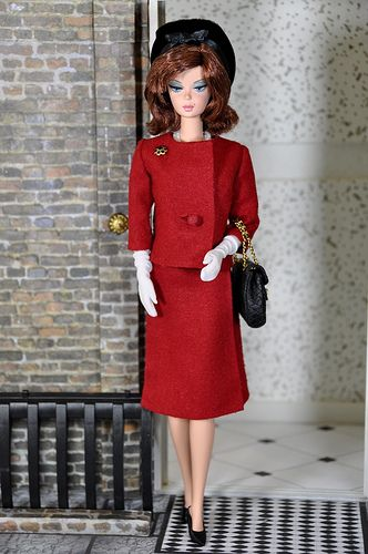 Barbie as Jackie Kennedy wearing her claret-red suit that she wore when giving the tour of the White House in 1962.
