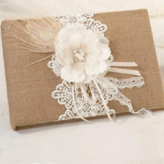 Guests will find themselves signing this unique burlap and lace guest book as they arrive at the reception. The guest book is covered in burlap and decorated wi
