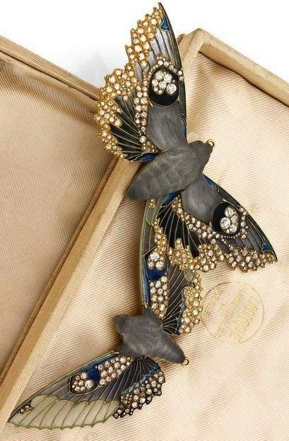 "Lalique ""Night Moths"" brooch, circa 1907. Gold, diamonds, plique-a-jour enameling, molded pate-de-verre glass bodies, Designed with rings enabling it to also be worn as a pendant. Original box."