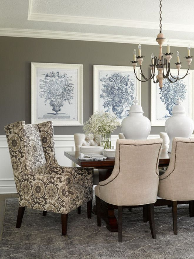 dining room walls in deep gray provide background for a grouping of large-scale art