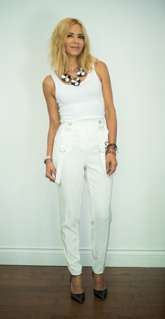 This Summer, pair your favorite white tank top with white suspender pants, a statement necklace, and black pumps.