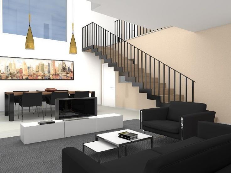 Interior, zona de estar, con su doble altura, sus grandes ventanales orientados a sur, y la escalera escultorica.