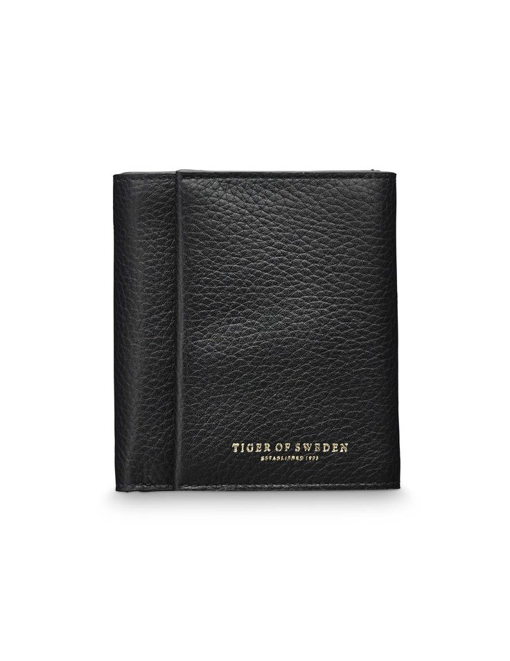 Agnello wallet - Women's trifold wallet in grain leather. Embossed Tiger of Sweden logo. Interior: five card slots; one cash sleeve, one coin compartment with zip closure. Size: 10 x 11 cm.