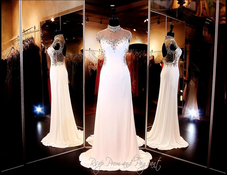 Old Hollywood glamour exudes from this timeless Ivory Gown with an illusion turtle neckline bodice. Its cap sleeves are edged with dazzling crystal jewels. Slim fitting and sheer at the back, this gorgeous gown finishes with a stunning train. ONLY at Rsvp Prom and Pageant, Atlanta, GA. Buy it HERE at http://rsvppromandpageant.net/collections/long-gowns/products/ivory-formfitting-prom-dress-high-illusion-neck-open-back-115ec0151190