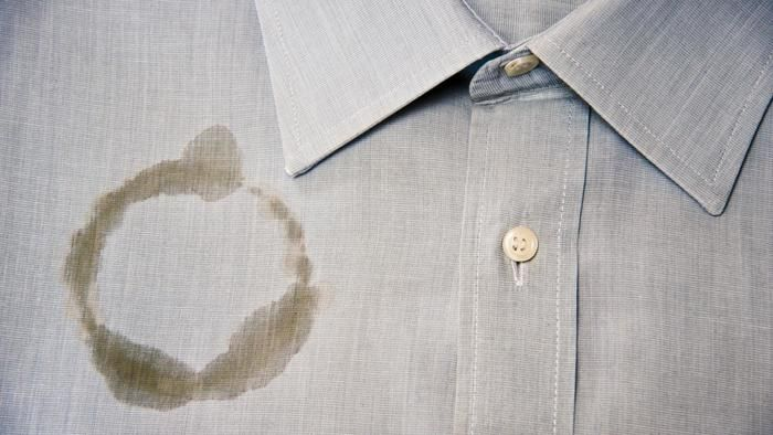 How do you remove oil and grease stains from polyester?