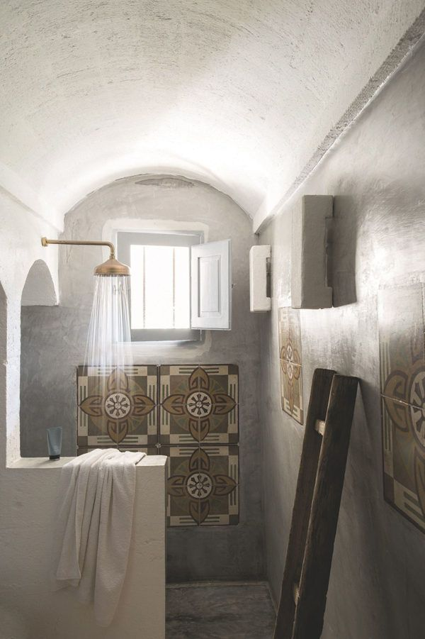 Patterned tiles and concrete in the rustic bathroom in a dreamy home in Puglia. Photo: Fred Vasseur.