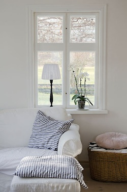 white with striped cushions