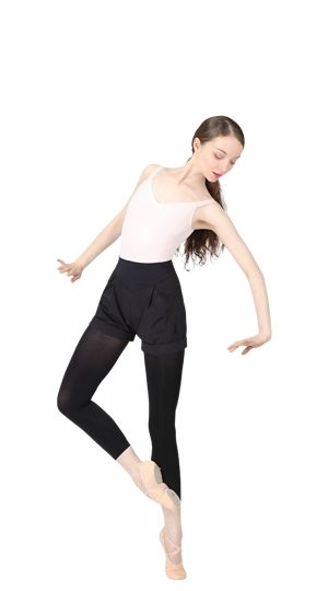 Warm-up shorts, footless dance tights and professional soft ballet shoes with split sole by Repetto.