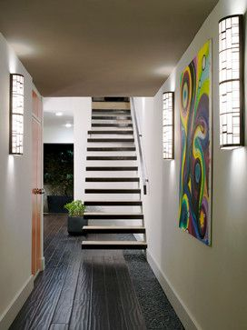This Airy, Contemporary Entrance Is Lit By Several Chic Wall Sconces And  Features A Dark Brown Wood Floor And Floating Stairs. Psychedelic,  Multi Colored ...