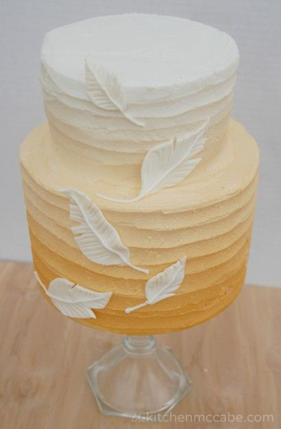 Gold ombre feather birthday cake. Inside is vanilla cake layers filled with strawberry cream cheese buttercream.