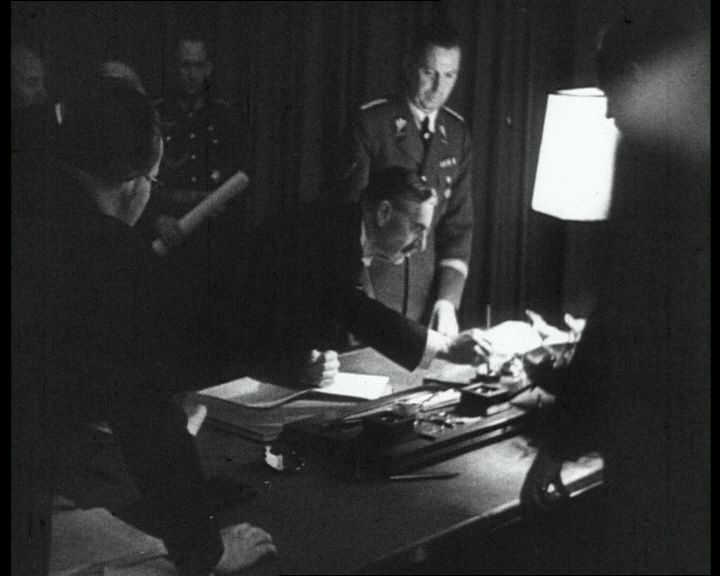 Watch footage of Chamberlain and Hitler signing the Munich Agreement in 1938: http://www.britishpathe.com/video/munich-signing-mussolini-chamberlain-daladier