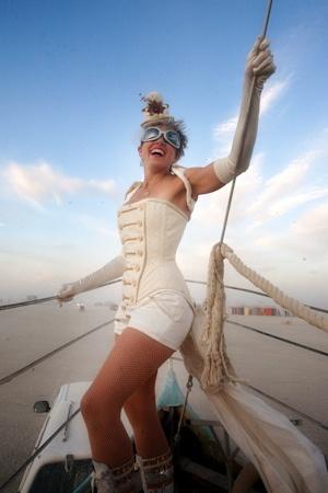 "Client Helen in bridal Dollymop for Dark Garden ""Lancer"" overbust corset ensemble, at Burning Man."