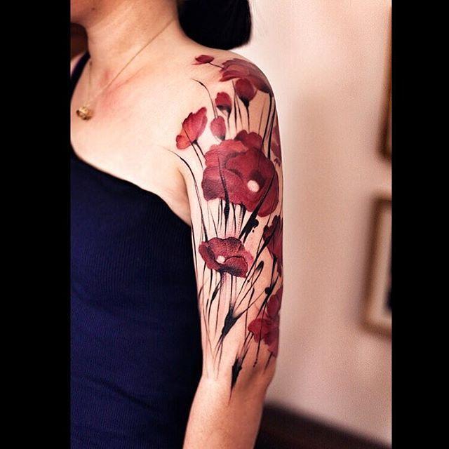 many red poppy flowers on shoulder