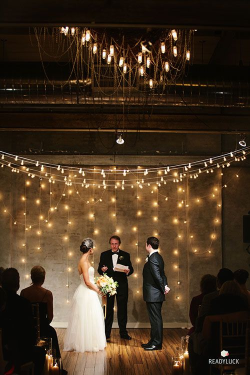 Backdrop lights at a wedding ceremony are intimate and romantic   Brides.com