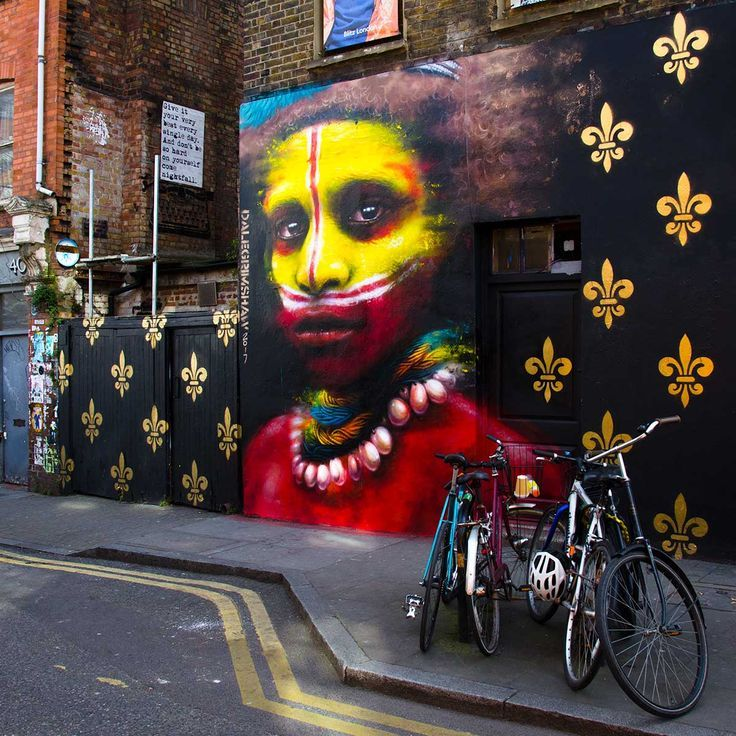 Street Art London. A stunning tribal portrait by artist Dale Grimshaw mixing threatened indigenous tribes with western symbolism. Hanbury Street, Shoreditch, London, UK. Taken March 2017.
