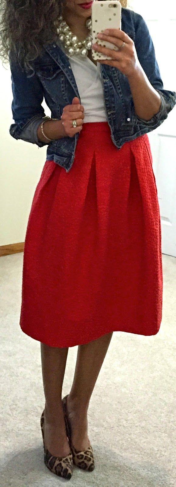 Red midi skirt, denim jacket, & pearls.