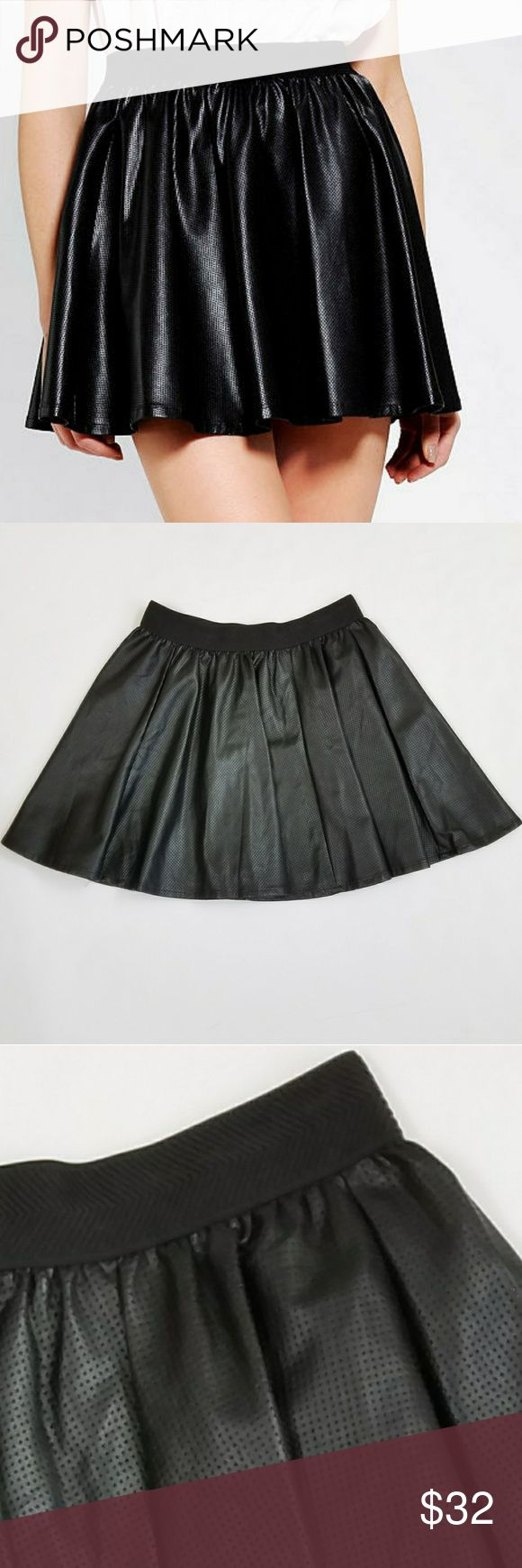 Silence + Noise Vegan Leather Skater Skirt sz S From Urban Outfitters Silent + Noise Perfotated Vegan Leather Skater Skirt Sz S. Like New condition. Lined. Elastic waistband Perforated vegan leather Machine washable Waist:13 inch laying flat Length: 16 inch silence + noise Skirts Mini