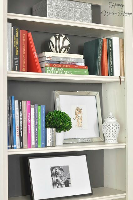 art and books in built in bookcase styling