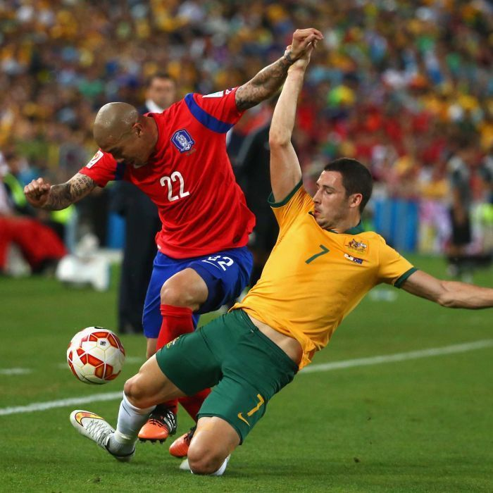 Leckie tackles Cha in Asian Cup final - Cha Du Ri of South Korea is challenged by Mathew Leckie of Australia during the 2015 Asian Cup final match at Stadium Australia on January 31, 2015 in Sydney.