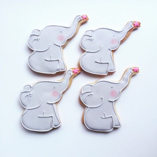 Baby elephant decorated favor cookies for a baby shower.