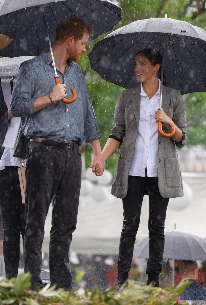 meghan markle and prince harry look ridiculously in love in the rain harry and meghan meghan markle prince harry prince harry meghan markle prince harry