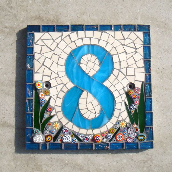 Mosaic House number sign made to order.  This one was made from stained glass, matt ceramic tile and Italian millefiori on a square Corian base