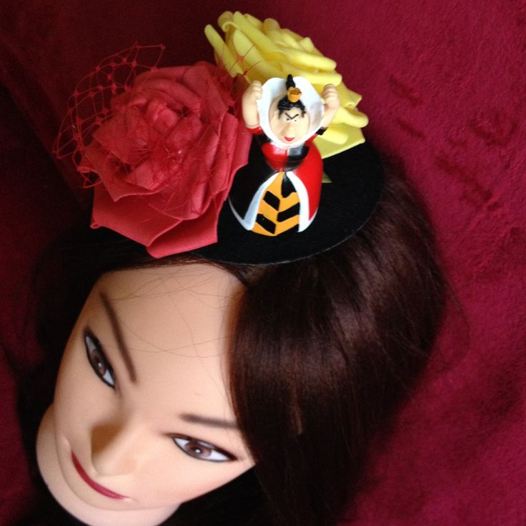 Little black hat, decorated with two large yellow and red roses, two leaves in the same colors and a figure of the Red Queen. #Minihat #veil #Carnival #Halloween #Christmas #ValentineDay #NewYear #costumeparty #minihats #Alice #AliceintheWonderland #MadHatter #minicylinder #cylinder #rabbit #RedQueen
