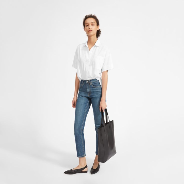 Pop on a bold shirt. This short-sleeve popover shirt has a cool, voluminous shape and forward details—like a buttonless placket, a step hem, and dropped shoulders.