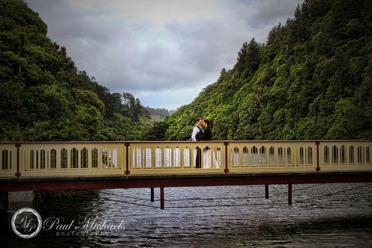 Wedding couple on the karori wildlife sanctuary bridge