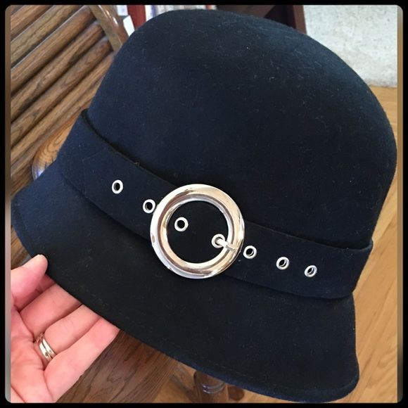 """Gifted100% Wool Black Bucket Hat with Buckle NWOT Never worn!  Such a cute hat & is a nice quality 100% wool, feels like felt.  Brim front 2 1/2"""", brim back 1 3/4"""". Inside circumference at band is 23"""". Inside depth is 5"""" to band (beginning of brim).  Used flash to show details in picture 2 but 1st pic is accurate to color.  It's a deep black color.  This is a very nice hat! .  Need more info, please ask.  Offers are okay ;) Accessories Hats"""