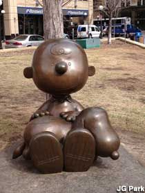 """Charlie Brown and Snoopy - bronze statue in St. Paul, MN by artist Tivoli Too. Charles Schulz, creator of the """"Peanuts"""" characters, was born in St. Paul."""