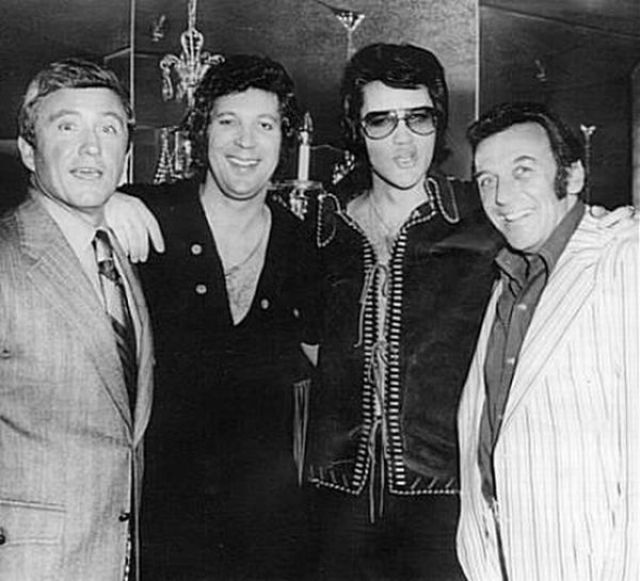 TV host, musician, actor, and media mogul Merv Griffin, singers Tom Jones and Elvis Presley, and comedian Norm Crosby. That's a whole lotta '70s style!
