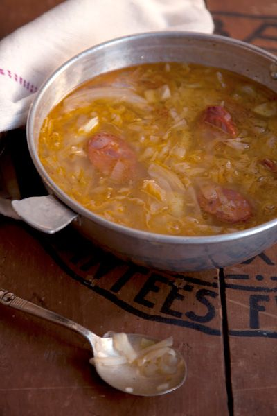 Spicy Cabbage and Chorizo Soup Recipe - This riff on the traditional Portuguese soup, Caldo verde, replaces the more common kale with savoy cabbage and spices things up with chile flakes.