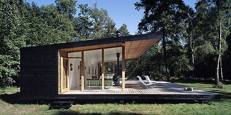 Side view of Danish holiday house designed by Christensen architects. Simple ,neat