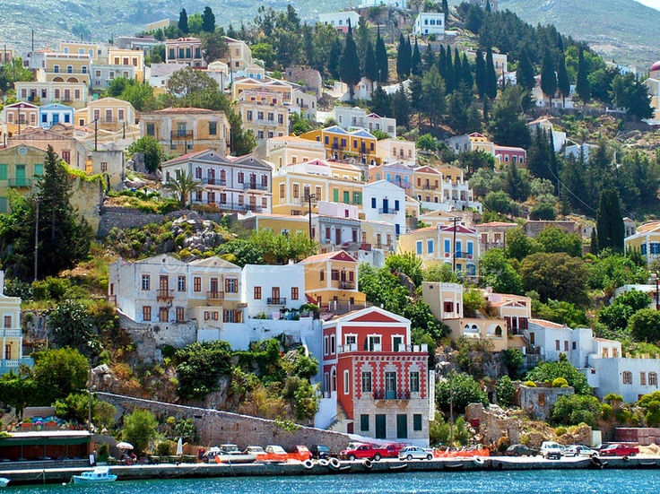 """Classically proportioned houses in bright ice cream colours"" #Symi Island, #Greece"