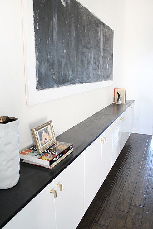 Floating kitchen cabinets are low-profile enough to be used as a hallway or dining room console.