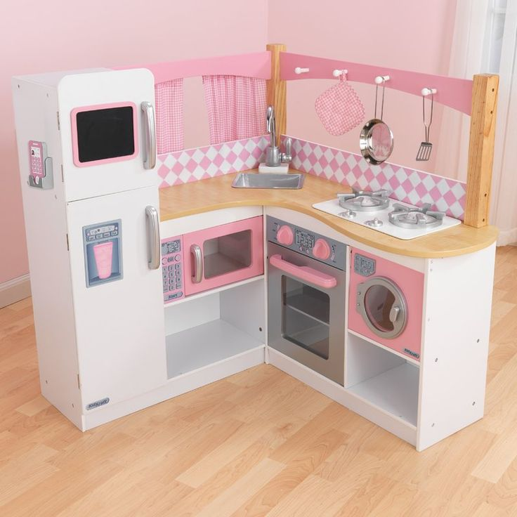 Keep your children occupied with the KidKraft Grand Gourmet Corner Kitchen. This kitchen set includes washing machine, oven, microwave, washbasin, and refrigerator with realistic doors. Made from a high-quality material, this kitchen set is strong and durable. It is accentuated with a hand painted pink and silver finish. There is a chalkboard, where your kids can write the grocery list or things to do. The Grand Gourmet Corner Kitchen by KidKraft is eco-friendly and causes minimal impact on…