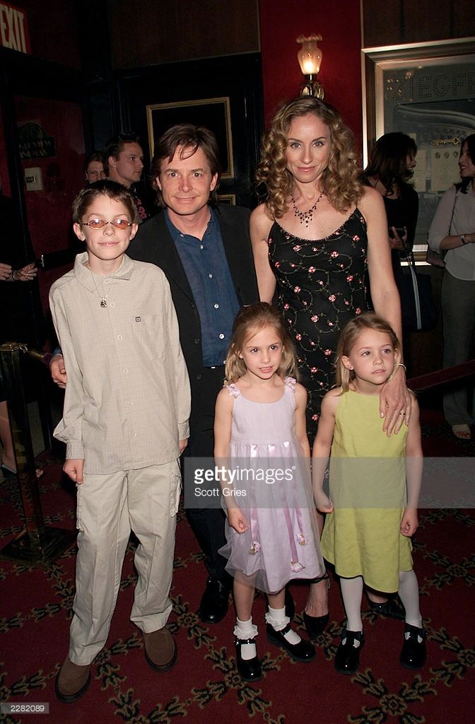Michael J. Fox arrives with his family, wife Tracy, son Sam, and twin daughters Schuyler(in yellow) and Aquinnah, at the New York premiere of the new Disney film 'Atlantis: The Lost Empire' at the Ziegfeld Theater in New York City. 6/6/01 Photo by Scott Gries/Getty Images