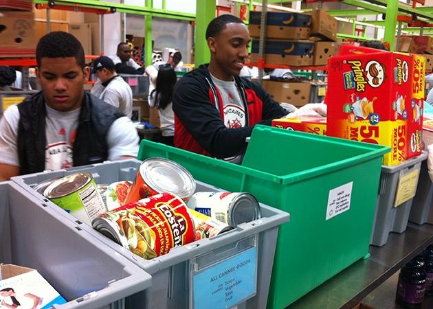 Jeff Teague helps to package food at the Houston Food Bank for NBA Cares Day of Service.